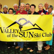 Left to right: Nancy Adams, Jane Sweet, Rose Geller, Ted McGovern, Lew Geller, Dave Geurden, Sharon Geurden, Lynn Warren, Jim Jarvis and Carol Jarvis hold the newly designed club banner.