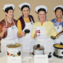 The Soupettes serve up their favorite recipes at the recent PC Singles Soup Tasting Party hosted by member Dan Miczek. 