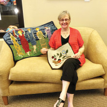 Sally Holmboe with her finished rugs.