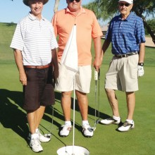 Goofy Golf participants at pizza-size cup at 16th hole (left to right) Bob LeClair, Steffen Jacobson and Don Morris