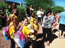 Five of our campers with our camp chairman, Sandy Blackburn, waiting to get on the bus to camp.