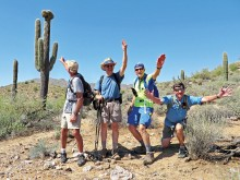 Left to right: Clare Bangs, Pete Williams, Lynn Warren (photographer) and Bill Halte clowning for a selfie with a crested saguaro in the McDowell Sonoran Preserve.
