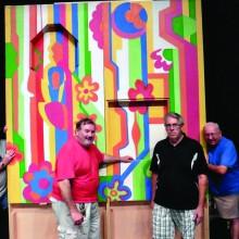 Joe Wallace, Bill Silverman, Joe Salerno and Mike Ramsey construct PebbleCreek's own Laugh-In joke wall for A Night at the Renaissance.