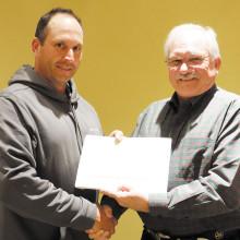 Paul McGinnis presents Employee of the Month award to Todd Drazkowski (left).