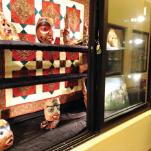 PebbleCreek Woodcarvers Club display of recently carved masks in the Creative Arts Center; backdrop was supplied by the PebbleCreek Quilters.