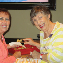 Diane Seeber with Laurie Overson; Diane sampled the Caramel Roll several times.