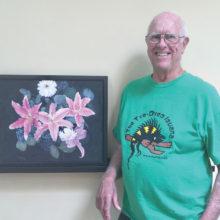 Tom Gallob displays his acrylic painting Oriental Lily.