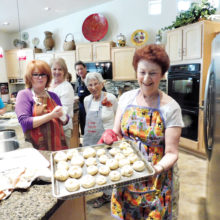 Hermine Sulzberg holding the knishes yet to be baked from those who participated in her Knish Klass