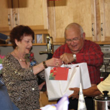 Members of the PebbleCreek Car Club enjoy a lively gift exchange at their annual holiday party.