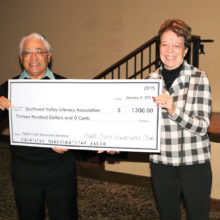 Bart Alford awards check to Jan Cosgrove of SWVLA