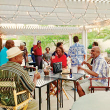 Members and guests enjoy each other's friendship under the stars.