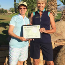 Carol Horan, the PCL9GA representative to the Arizona Women's Golf Association, presents Arlene Greenberg with a hole-in-one certificate from the Association.