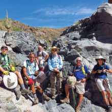Left to right: Lynn Warren (photographer), Mark Frumkin, Clare Bangs, Pete Williams, Dennis Zigmunt and Susan Rudoy pause after lunch on giant boulders in the Agua Fria riverbed.