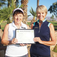 Carol Horan, the PCL9GA representative to the Arizona Women's Golf Association, presents Pat Kaer with a Hole-in-One certificate from the Association.