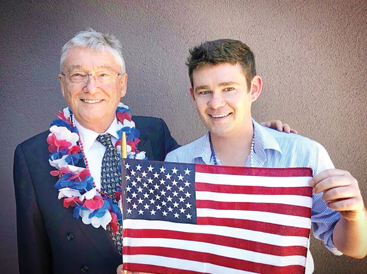 Proud new American Citizen Tony Ryan and his son Mike.