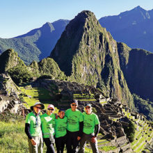 """Left to right: Lynn Warren, Julie Walmsley, Marilyn Reynolds, Diana Bedwell and Dave """"Ausy"""" Ausman paused for a photo op after a 26-mile trek to iconic Machu Picchu."""