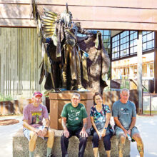 Left to right: Lynn Warren, Len Jeffery (London), Adriana Greisman, and Paddy Hoy paused at the Bear Tracks sculpture on an outing to the Scottsdale Museum of the West.