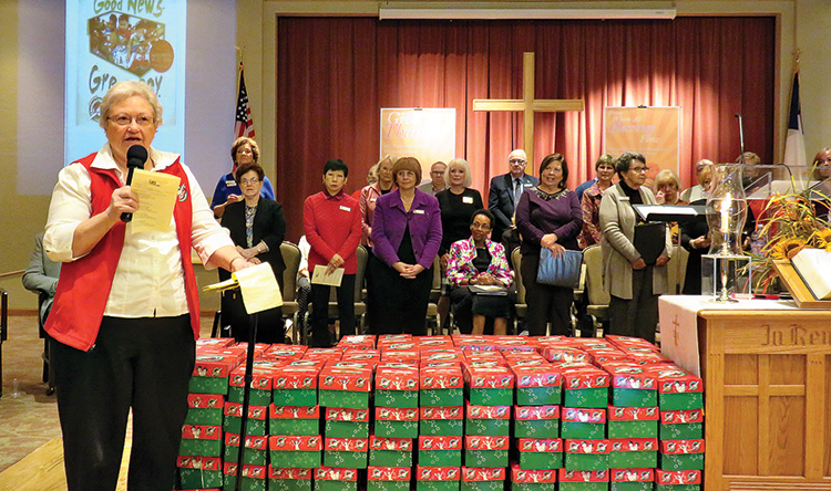 Edna DeFord and Shoe Box Committee dedicate a small portion of the shoe boxes packed by church family.