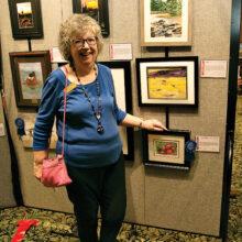 Marsha Lyons enjoys artwork at PCAC Fall show.