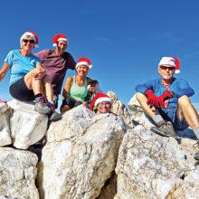 Left to right: Julie Walmsley, Clare Bangs, Kris Raczkiewicz, Neal Wring, and Lynn Warren (photographer) relax on giant blocks of white quartz on the summit of Quartz Peak.