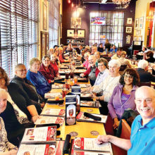 FFF members seated at BJ's Brewhouse's longest table.