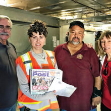 (Left to right): John Moore, PC Dem Club president; Jess Legaspi and Fidel Rodriquez, AFFCB staffers; and Judy Hart, co-chair, Community Benefits Committee with the PC Post at the Food Bank after dropping off a load of food.