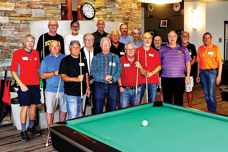 Billiard Club members Lynn (photographer), Jim, Rene, Jim P., Ken, Brian, and Johnny pose with Vistancia players prior to an inter-community 8-ball match on March 12.