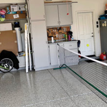 Renee deLassus and Andrea Dilger volley in the garage.