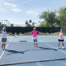 PC tennis players Donna Armbruster, Jo Werner, and Shelley Bain (left to right) were practicing social distancing on the first day of phase one on the Tuscany Falls tennis courts.
