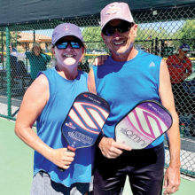 Kim and Gary Mattevi playing mixed doubles on the courts!