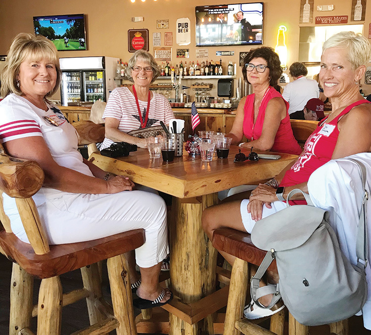 Nancy Moore, Cindy Zaklan, Jodie Heinz, and Cindy Finnegan seated at one of the many high tops in the pub.