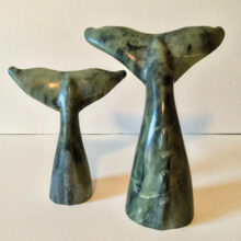 """Lyle Chrisman used soapstone to hand carve """"Whales Tails."""" A soapstone carving is finished by applying hot wax to give the piece a shine."""