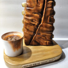 """Lyle Chrisman carved the """"The Unit 43A B-BQ Rib Cook-Off Champ"""" award. Lyle airbrushed the ribs and sauce bowl."""