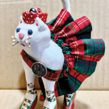 """Jeannette McElroy is a cat lover. She carved, painted, and embellished her """"Princess Ladybug."""""""