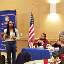 Kyra Horton presents an Interact Club update during a Rotary Club of Surprise meeting.