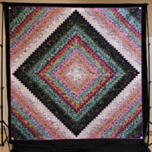 """""""A Godwin Watercolor Trip"""" was pieced by Sue Godwin and quilted by Linda Publicover."""