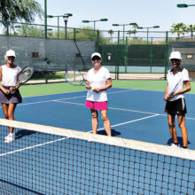 Jo Terry, Norma Whitley, and Jude Tarkowski, out on the courts for some morning exercise.
