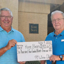 Culver Stone (left), President of the PebbleCreek Wine Club, presented Tom Meek (right), President of the Kare Bears, with a check for $6,493.65 on Nov. 4. That donation brings the PebbleCreek Wine Club's financial support of Kare Bears, over the last three years, to $26,493.65.