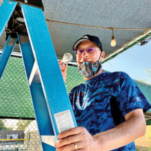 Steven Schaefer changing light bulbs at the pickleball courts.