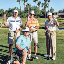 """Jim Mitchell watches as Brad Hedien, Chuck Akers, and Joe Belonax get ready for the """"Two-Three-Four"""" Tournament on Sept. 10. Their team tied for second place."""