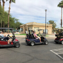 Carts in a staging area for the Tour de Eagle's Nest.