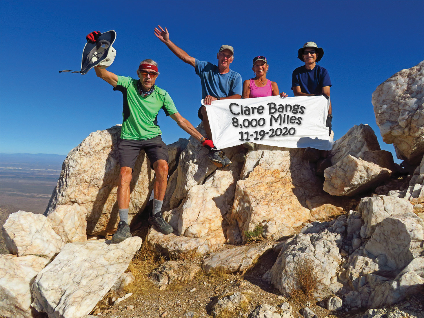 Left to right: Lynn Warren (photographer), Clare Bangs, Marilyn Reynolds, and Mike Tansey celebrating Clare's achievement on Quartz Peak, where the drive to get there is as challenging as the climb.