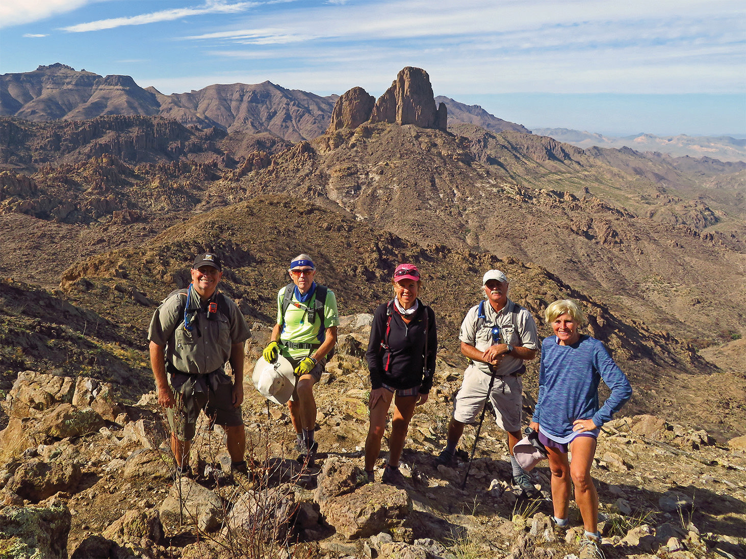 Left to right: Neal Wring, Lynn Warren (photographer), Kris Raczkiewicz, Steve McElroy, and Eileen Lords-Mosse pausing on top of Bluff Springs Mt. with Weaver's Needle in the background.