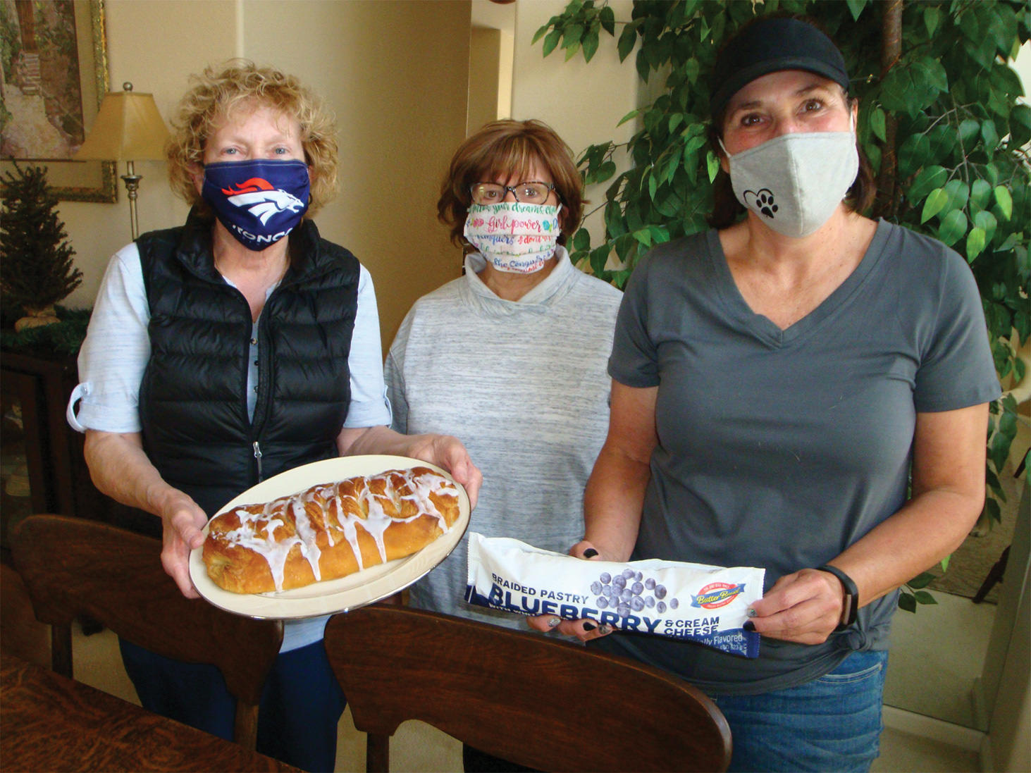 T.T.T. president Jan Stash is flanked by Maura Weddle and Carol Rice as plans are happily finalized for the Butter Braid Bread Fundraiser.