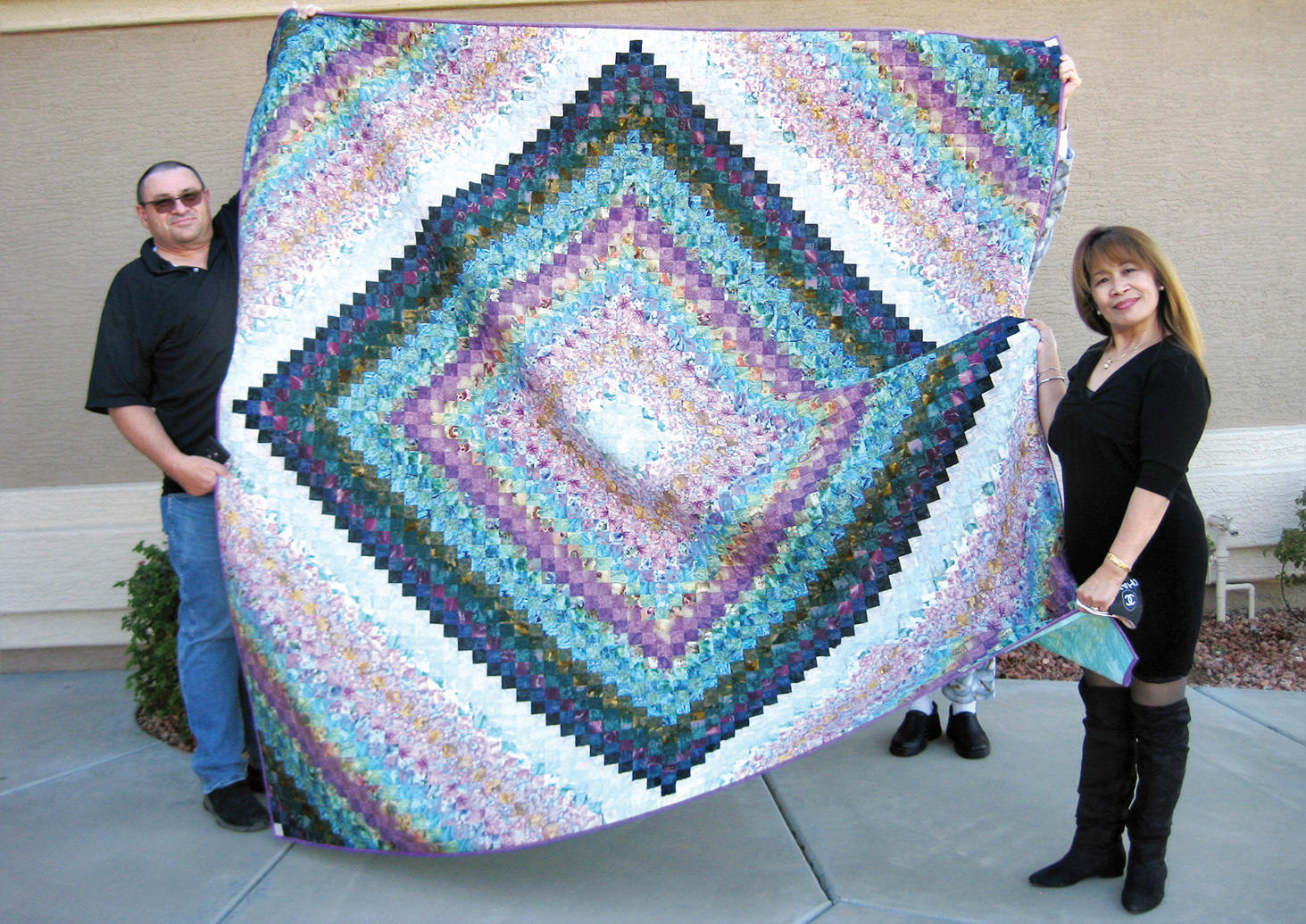 Joel and Virgie Manley with the 2020 Opportunity Quilt