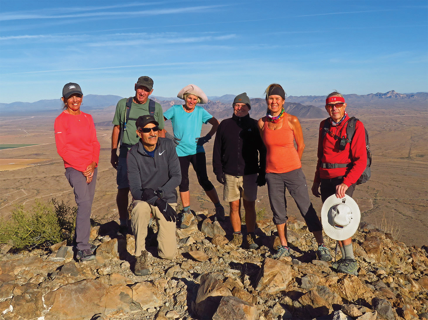 Left to right: Marilyn Reynolds, Clare Bangs, Mike Tansey, Eileen Lords-Mosse, Neal Wring, Kris Raczkiewicz, and Lynn Warren (photographer) enjoying 360-degree views from the summit of Saddle Mountain.