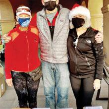 Pam Lichtenberger (volunteer), Wade Johnson (tournament director), and Pam Cagle (volunteer).