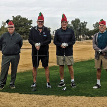 """PCM9GA elves leave Santa's workshop for a quick nine on Christmas Eve (left to right): Mike Brown, """"Jingles;"""" Joe Oliver, """"Snowflake;"""" Fred Schmidt, """"Gildor;"""" and Josh Rabinowitz, """"Poldo."""""""