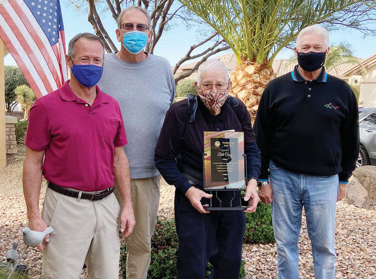Bill Casey (holding plaque) with PebbleCreek Gun Club officers (left to right) Mitch Counce, Dan Borchers, and Jerry Younker.