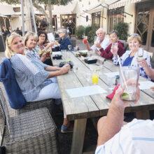 Members of the PebbleCreek Singles Club enjoying happy hour on the patio at the Wigwam Resort.